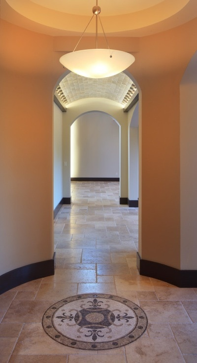 Indirect LED lighted hallway in a Modern-Mediterranean home designed and built by Orlando Custom Builder Jorge Ulibarri
