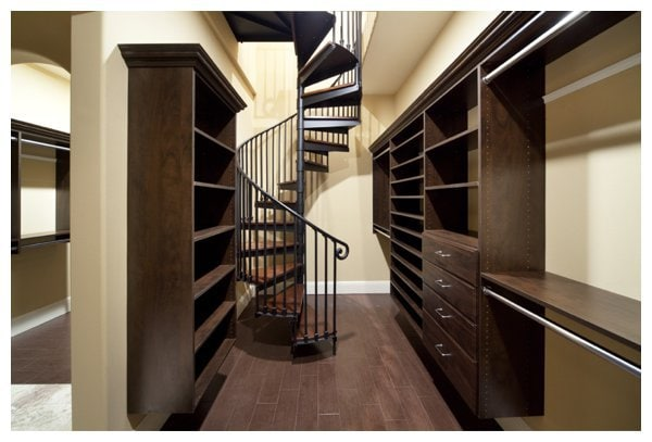 a spiral stairway leads to the second floor craft room over the master closet that becomes a beautiful look out tower on the exterior in Villa Capozolli, designed and built by Orlando Custom Home Builder Jorge Ulibarri.