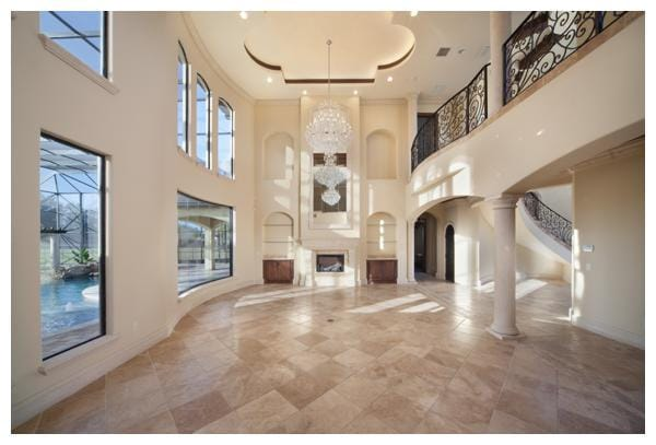 Villa Verona features an open floor plan with two-story grand main living spaces anchored by a quatrefoil ceiling treatment and 3 crystal chandeliers. The home was built by Orlando Custom Home Builder Jorge Ulibarri www.ImYourBuilder.com