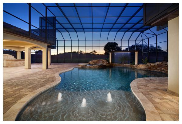 Villa Verona opens to a grand outdoor living space with an oasis-style pool by Ultimate Pool Design. Villa Verona was built by Orlando Custom Home Builder Jorge Ulibarri www.ImYourBuilder.com