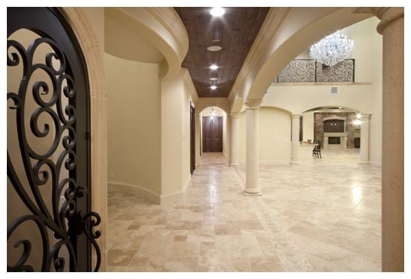 Dark-stained knotty pine doors enrich the home's interior decor and complement wood plank ceilings adding warmth to the living spaces in Villa Verona, built by Orlando Custom Home Builder Jorge Ulibarri www.ImYourBuilder.com