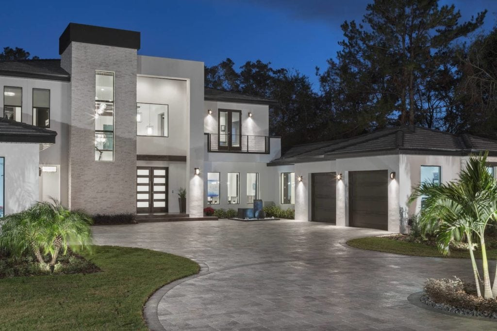Inverted L Entry Tower defines the curb appeal of this Florida Modern Home designed and built by Orlando Custom Home Builder Jorge Ulibarri www.imyourbuilder.com