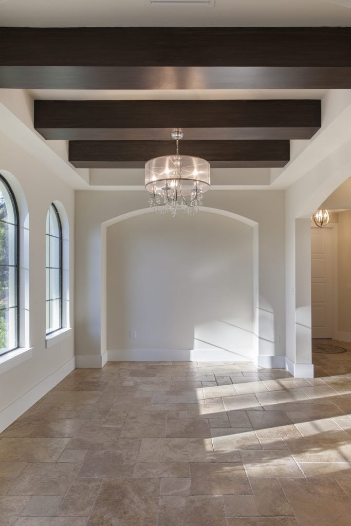The formal dining room in this Lake Nona home designed and built by Orlando Custom Home Builder Jorge Ulibarri.