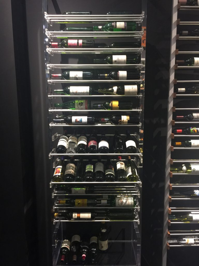 Modern wine shelves that pull out in this temperature controlled wine room.