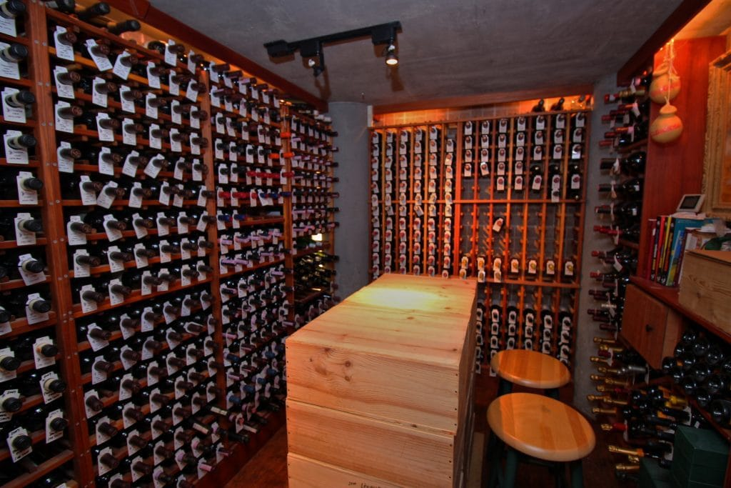 Individual storage racks in a temperature controlled wine room. For more design tips and advice on building a custom home, check out the blog by Orlando Custom Home Builder Jorge Ulibarri at www.imyourbuilder.com