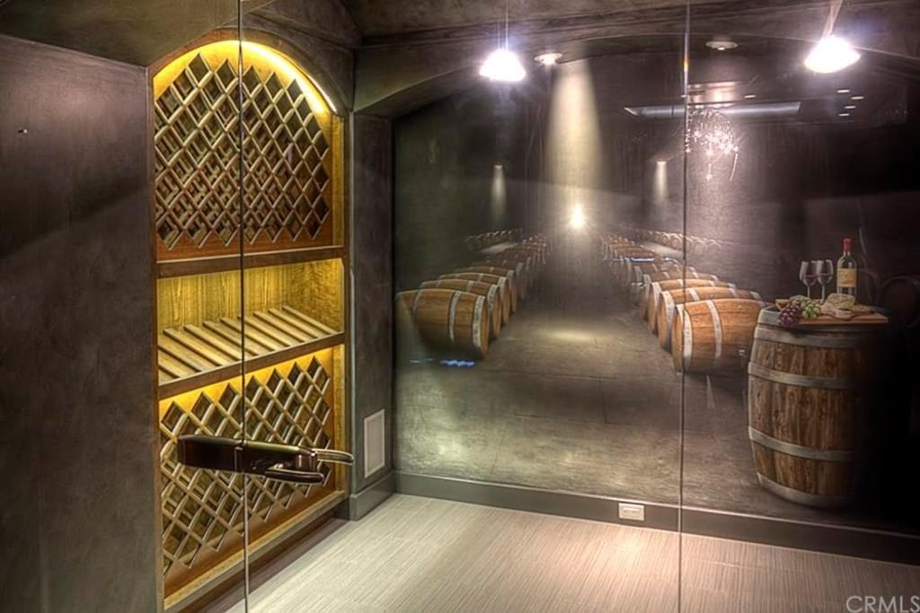A painted mural in this wine room adds a decorative element and a 3D effect of being part of a larger cellar.