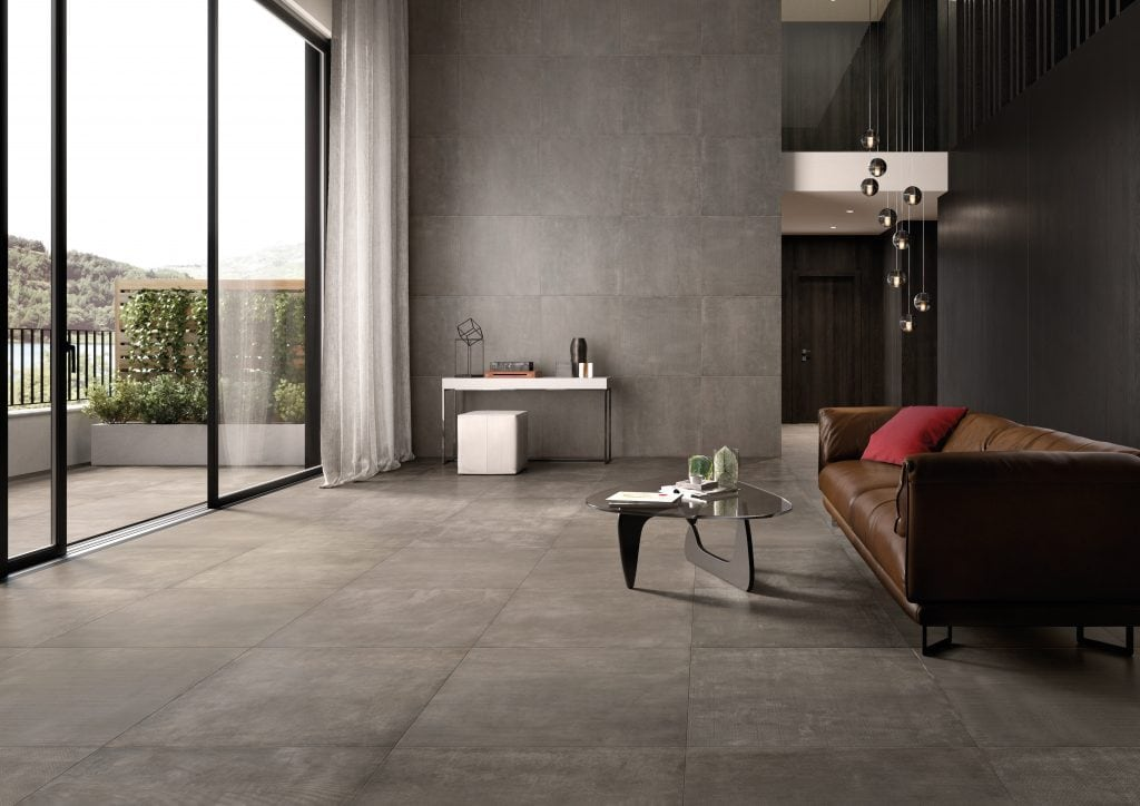 Orlando Custom Home Builder Jorge Ulibarri shares flooring tips for various stone and ceramic tile choices including Ceramic tile that looks like concrete from the Network collection by Cerdisa. Photo credit: Cersaie