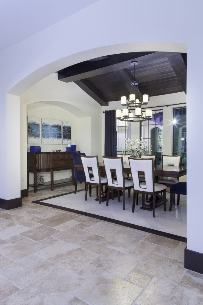 The only formal living space is the dining room in Villa Sirena, an Orlando Custom Home that is a blend of Spanish Mission Architecture and Contemporary design elements by Orlando Custom Home Builder Jorge Ulibarri of Cornerstone Custom Construction
