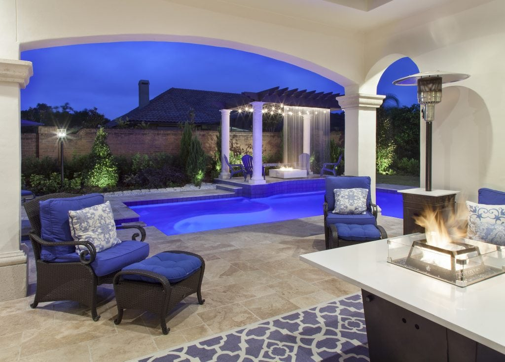 Resort-style outdoor living spaces in Villa Sirena, a home by Orlando Custom Home Builder Jorge Ulibarri.
