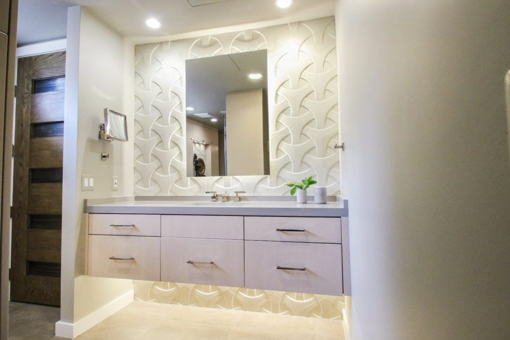 NKBA award-winning bathroom designed by Andrea Lupo features the popular floating vanity and under cabinet lighting.
