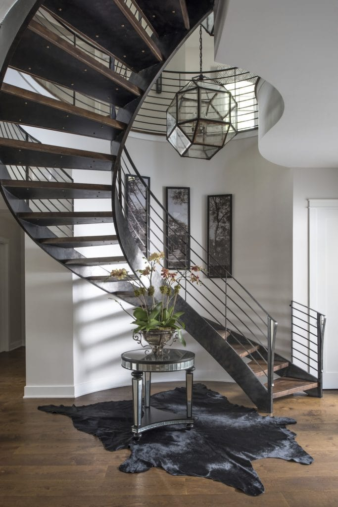 This floating staircase curves to stylishly accommodate a narrow space in the foyer. For more design ideas by Orlando Custom Home Builder go to www.cornerstonecustomconstruction.com