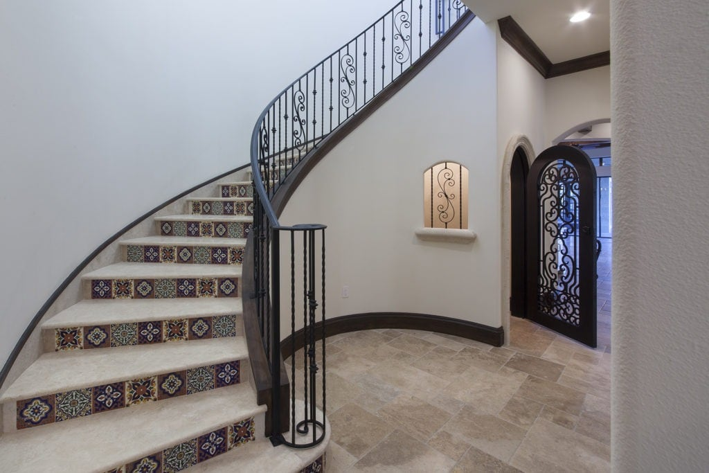 Orlando Custom Home Builder Jorge Ulibarri designed and built this staircase in a Lake Nona home with a walk-in wine storage room. For more design ideas by Orlando Custom Home Builder go to www.cornerstonecustomconstruction.com