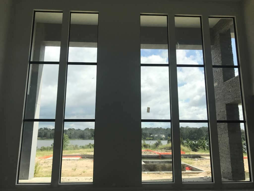 Floor to ceiling windows in this Florida Modern home under construction by Orlando Custom Home Builder Jorge Ulibarri www.imyourbuilder.com