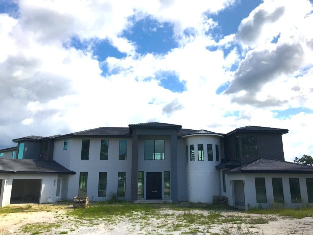 Florida Modern styled home under construction by Orlando Custom Home Builder Jorge Ulibarri spans 10,000 square feet and wraps around a ski and boating lake in Lake Markham Preserve. www.imyourbuilder.com