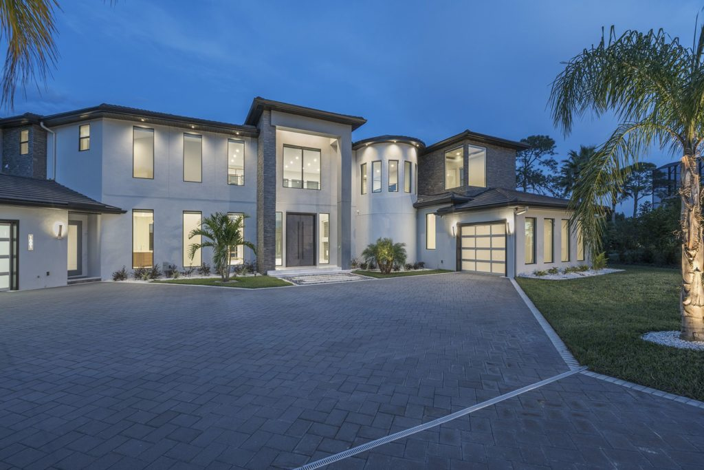 New modern classic architecture defines this 12,000 square foot custom home by Orlando Custom Homebuilder Jorge Ulibarri