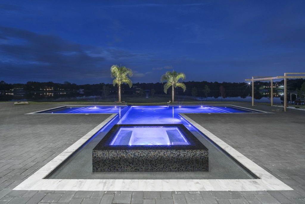 The linear pool and spa overlooking Lake Markham sit on a peninsula for sweeping views.