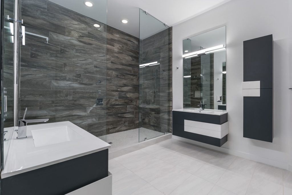 One of the six bathrooms in this 12,000 sq. ft. Florida Modern home by Orlando Custom Homebuilder Jorge Ulibarri.