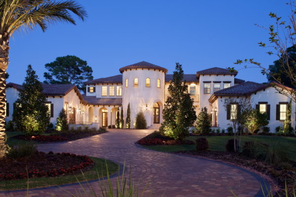 exterior luxury home palm trees brick driveway