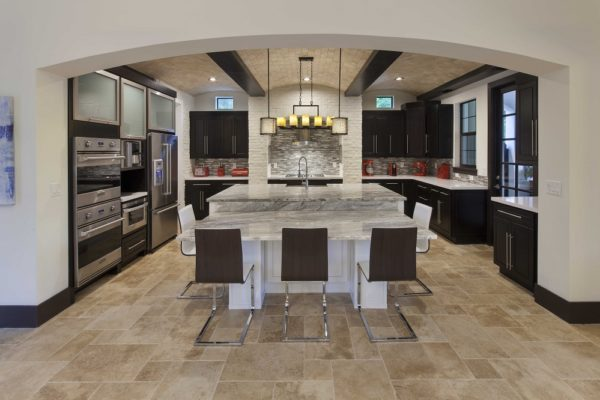 interior luxury home kitchen island refrigerator sink
