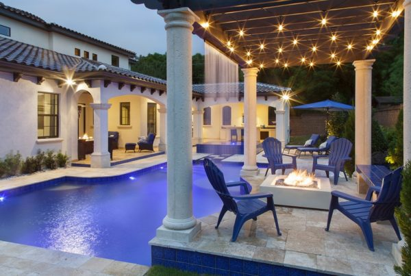 exterior luxury home pool, waterfall, firepit