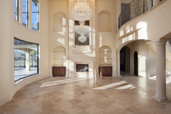 interior luxury home chandelier fireplace