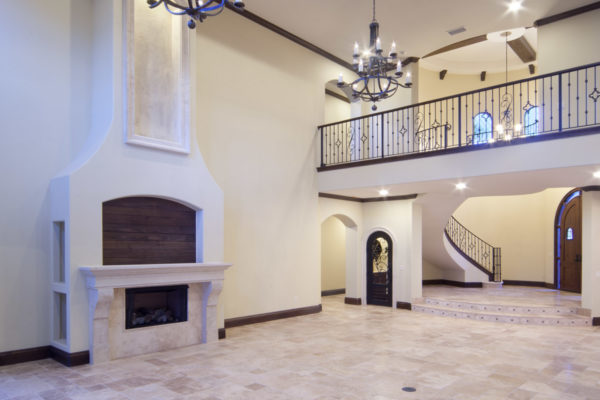 interior luxury home foyer, chandeler, staircase, fireplace