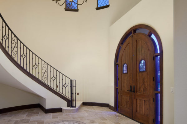 interior luxury home stairway front door