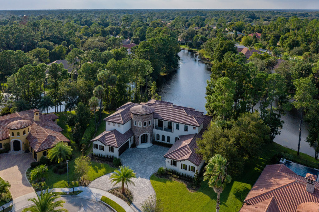 Mod-Mediterranean Custom Home by Orlando Custom Homebuilder Jorge Ulibarri. The 5,700 square foot home resides on a lake in the gated community of Lake Forest in Sanford, Florida.